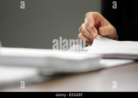 Royalty free photograph of business woman looking at business plan for  future financial ideas with corporate file. - Stock Photo