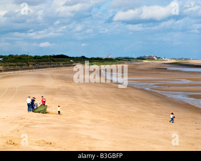 Family on Skegness beach in summer, Lincolnshire, England, UK - Stock Photo