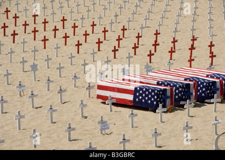 Arlington West memorial, Santa Monica Beach, California. Wooden Cross, Star of David, crescents and Flag drapped - Stock Photo