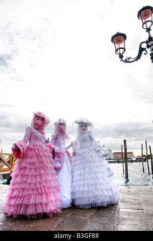 Three elegant masks in Venice Italy - Stock Photo