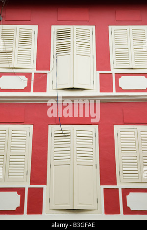Red and white building facade Chinatown, Singapore - Stock Photo