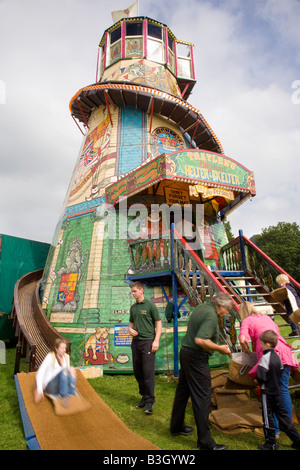 Old traditional wooden Helter-Skelter, a Childrens's fairground spiral  slide, at Chatsworth Country Fair Derbyshire, - Stock Photo