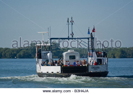 Car ferry ONGIARA with library bookmobile on board on way to Toronto Islands Park in summer in Toronto Ontario Canada - Stock Photo