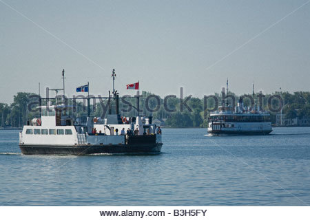 Car and passenger ferries on way to Toronto Islands Park in summer in Toronto Ontario Canada - Stock Photo