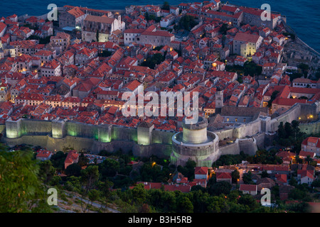 Dubrovnik in Croatia, evening and elevated view of old town from nearby Srdj mountain - Stock Photo