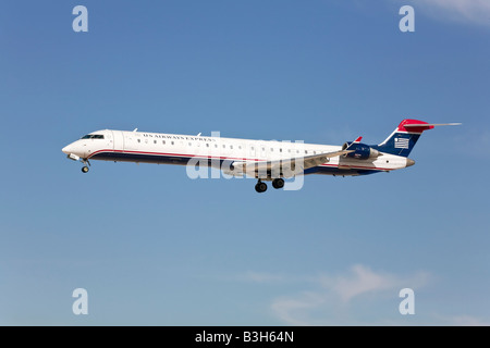 A US Airways Express Bombadier on finals at LAX - Stock Photo