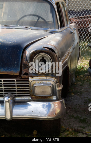 1956 chevy junkyard scrap car cars old forlorn abandoned rusty rust rusting classic american car us usa icon chevrolet - Stock Photo