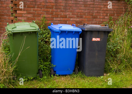 Three wheely bins of different colours for different waste items - Stock Photo