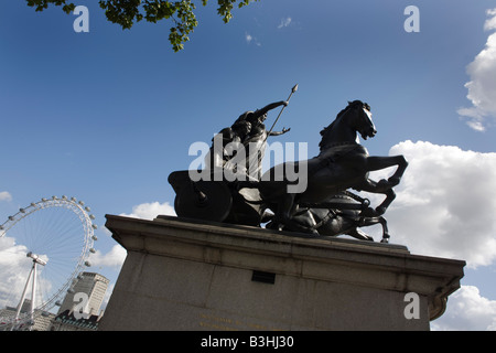 Queen Boudicca's (also spelt Boadicea) statue and the 135m high London Eye seen from the Westminster side of the - Stock Photo
