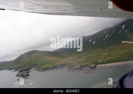 Flight seeing trip over the coast of Katmai National Park and Preserve in a Cessna 207 small air plane. - Stock Photo