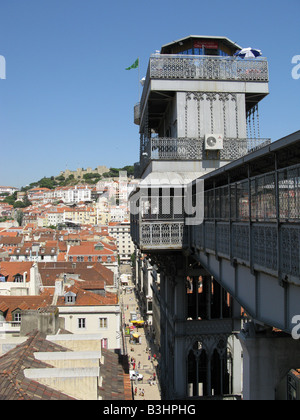 The Santa Justa elevator connects the central Baixa area to the higher Bairro Alto district. St.George's castle - Stock Photo