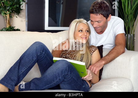 Young couple into apartment - Stock Photo