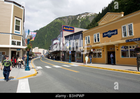 People strawling the streets of down town Juneau, The Capital of Alaska, Northern America - Stock Photo