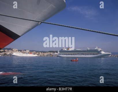 P&O ( P and O ) Cruise lines flagship Ventura + ferry viewed from beneath the bows of  Cruise ship Aidadiva, Palma. - Stock Photo