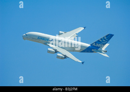 Airbus Industries A380 banking and climbing - Stock Photo