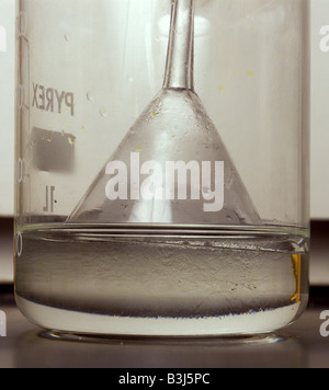 closeup of preparation of hydrochloric acid by dissolving hydrogen chloride in water - Stock Photo