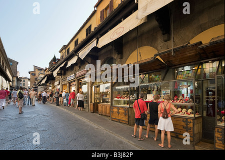 Shops on the Ponte Vecchio in the late afternoon, Florence, Tuscany, Italy - Stock Photo
