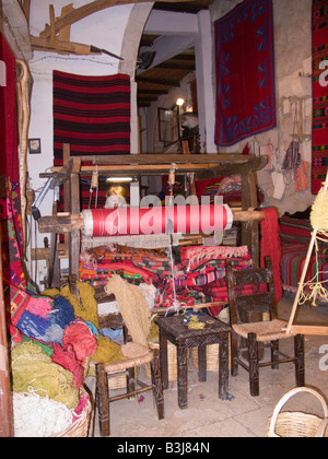 Chania Crete Woman Weaving on a traditional loom - Stock Photo