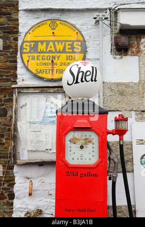 Vintage Shell petrol pump on old garage front,Cornwall - Stock Photo