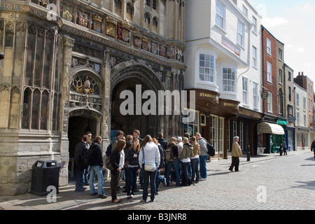 Tourists Congregating Outside The Gated Entrance To Canterbury Cathedral    Stock Photo