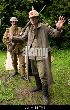 Two members of historical re-enactment societies wear the uniforms of a first world war infantry soldiers. - Stock Photo