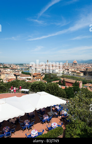 View over the city from Piazzale Michelangelo with cafe in the foreground, Florence, Tuscany, Italy - Stock Photo