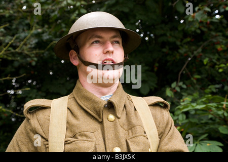 A member of a historical re-enactment society wears the uniforms of a British first world war soldier. - Stock Photo