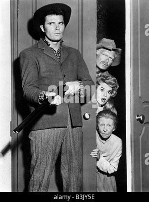 THE BEVERLY HILLBILLIES US TV series with Max Baer with gun and in doorway from top Buddy Ebsen, Donna Douglas and - Stock Photo