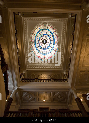 Boldt Castle Stained Glass Dome and central hall: Lighting the central stair this large dome four stories above - Stock Photo