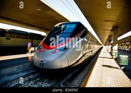 Eurostar Italia train about to leave Florence Station These High spped trains link up the major Cities of Italy - Stock Photo