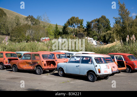 mini cars parked in a scrapyard - Stock Photo