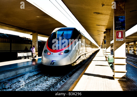 Eurostar Italia train about to leave Florence Station These High speed trains link up the major Cities of Italy - Stock Photo