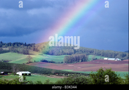 Rainbow over farmland Near Monroe Oregon - Stock Photo