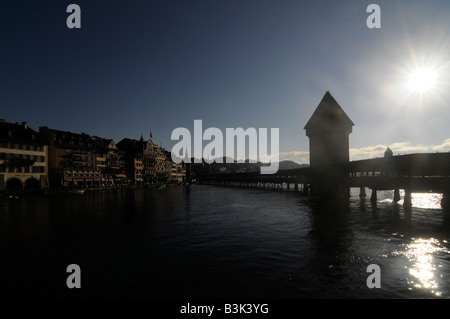 Silhouette of the Chapel Bridge and the Water Tower, a major tourist attraction in the town of Lucerne, in central - Stock Photo