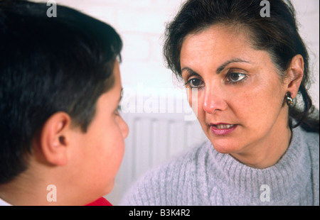 Mother Telling Off Young Son - Stock Photo
