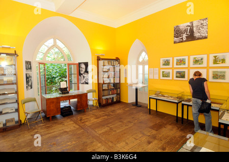 A visitor inside the museum dedicated to German writer Herman Hesse in Montagnola village in the Tessin region of - Stock Photo