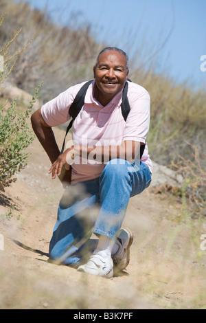 Senior man on a walking trail - Stock Photo