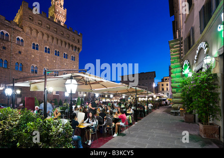 Restaurant at night in front of the Palazzo Vecchio in the Piazza della Signoria, Florence, Tuscany, Italy - Stock Photo