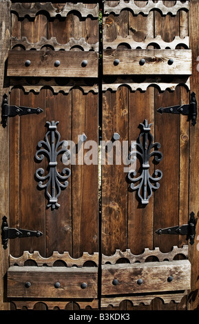 a worn out old wooden door - Stock Photo