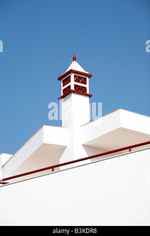 Traditional painted chimney on rooftop in Alte Portugal - Stock Photo