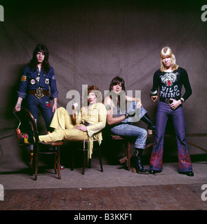 THE SWEET Promotional photo of UK glam rock group about 1973. From left' Mick Tucker, Steve Priest, Andy Scott, - Stock Photo