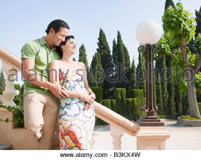 Couple hugging on outdoor staircase - Stock Photo