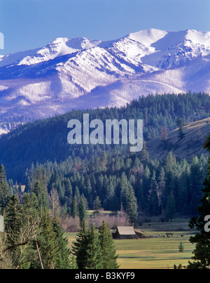 Barn and Wallowa Mountains with new snow Oregon - Stock Photo