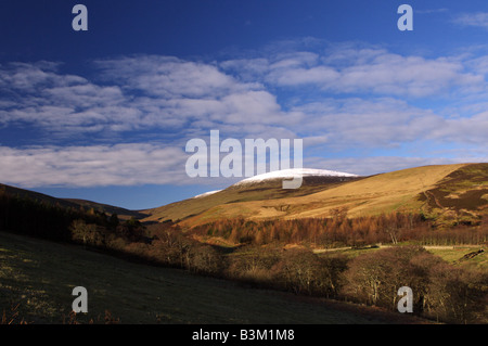 The Cheviot Hill top covered in snow on a bright sunny winters day. - Stock Photo
