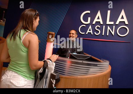 A SECURITY GUARD IN THE RECEPTION AREA OF A CASINO UK - Stock Photo
