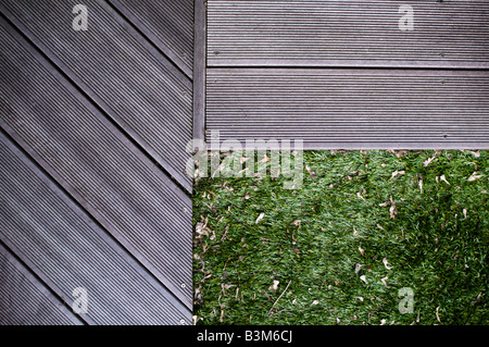 decking edges meet astro turf lawn - Stock Photo