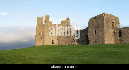 Turrets and walls of Dunstanburgh Castle looking North Eastwards Northumberland United Kingdom - Stock Photo