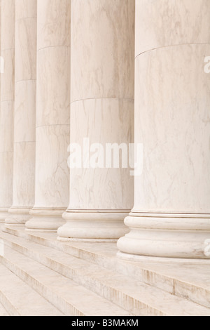 Roman Doric marble columns in a line above marble steps, ideal for classic background - Stock Photo