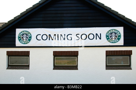 'starbucks' cooming soon sign on a roadside building in cornwall,uk