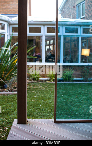 tinted perspex and wood gazebo in landscaped garden - Stock Photo